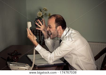 business man gesturing aggressive and shout on phone