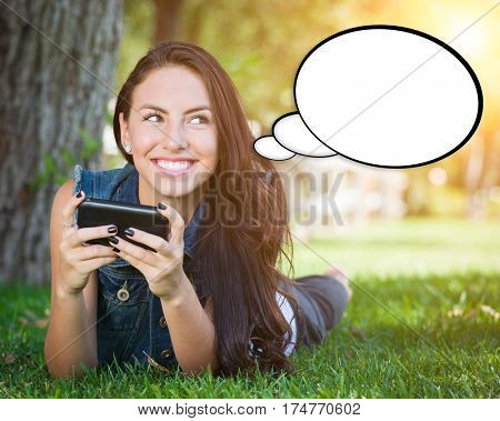 Thoughtful Young Woman with Cell Phone and Blank Thought Bubble.