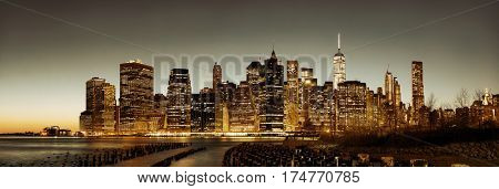 New York City downtown skyline panorama with pier remains at dusk