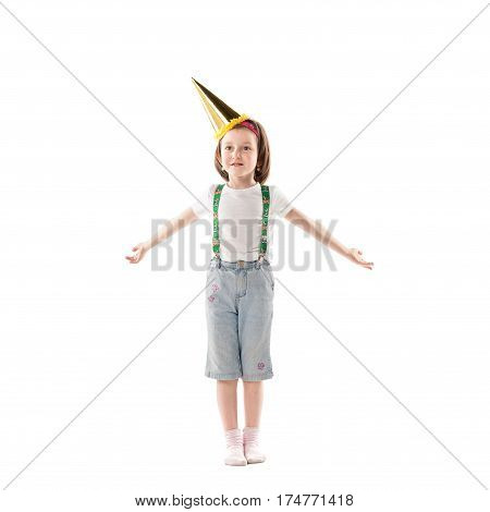 Where are the gifts? Small pretty girl in birthday cap making a helpless gesture. Isolated over white background