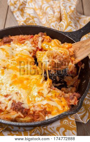 Cabbage casserole with beef, cheese and tomato sauce
