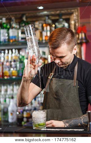 The Bartender Making Cocktail