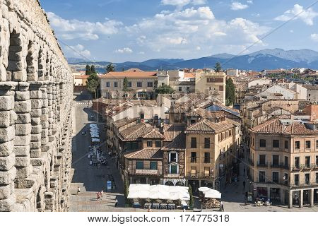 SEGOVIA, SPAIN - JULY 27, 2016: Segovia (Castilla y Leon Spain): the Roman aqueduct Unesco World Heritage Site and panoramic view of the historic city