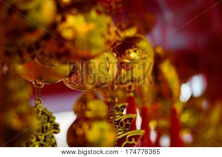 blurred photo, Blurry image, Chinese new year festival decorations ang pow or red firecracker and gold ingotsitems used in the belief that the good luck and wealth