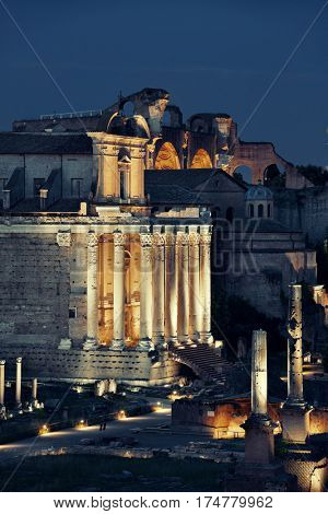 Rome Forum with ruins of ancient architecture at night. Italy.