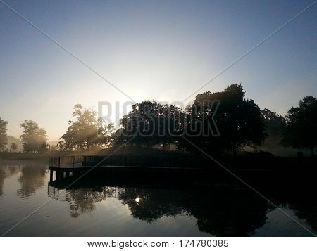 happy beautiful sunrise over pond in Lincol Park Chicago