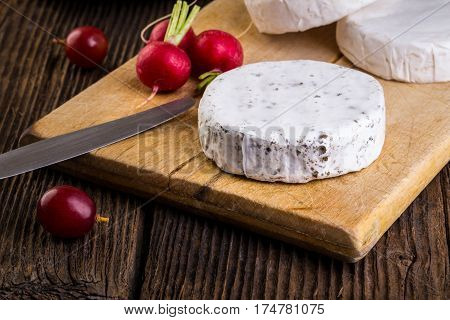 Cheese With White Mold, Grapes And Radish