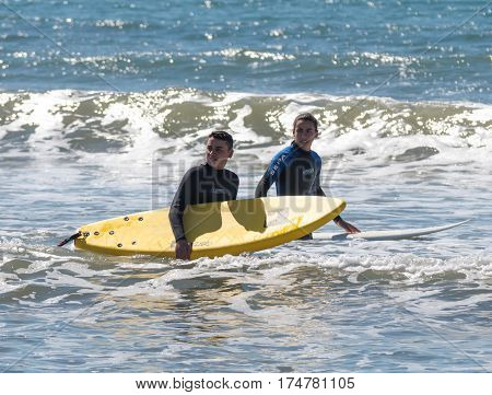 Young Men Exercising In Surfing On The Boards