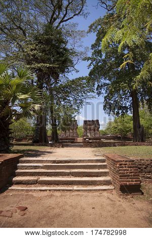 Royal Palace Polonnaruwa or Pulattipura ancient city of the Kingdom of Polonnaruwa in Sri Lanka between green tropical trees and palms