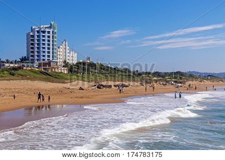 People On Morning Visit To Beach Against Blue Sky