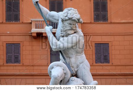 ROME, ITALY - SEPTEMBER 02: Neptune fighting with an octopus statue in the Fountain of Neptune in Rome, Italy on September 02, 2016.