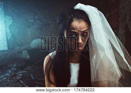 Disheveled bride with tear stained face