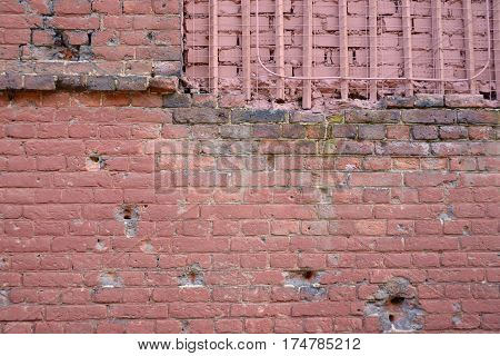 Brick wall with bullet marks close up