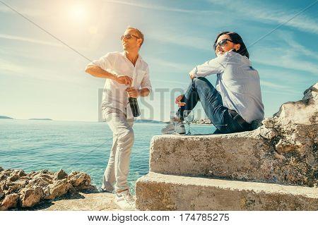 Romantic date with wine in the sea lagune.