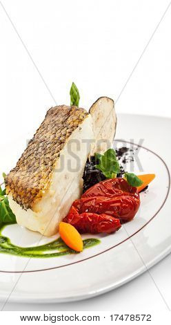 Chile Sea Bass (black sea bass) served with Black Risotto, Herbs and Vegetables poster