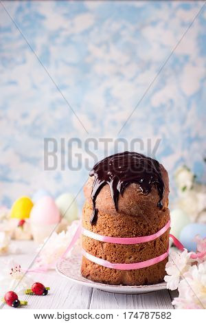 Easter cake and colorful eggs on festive Easter table