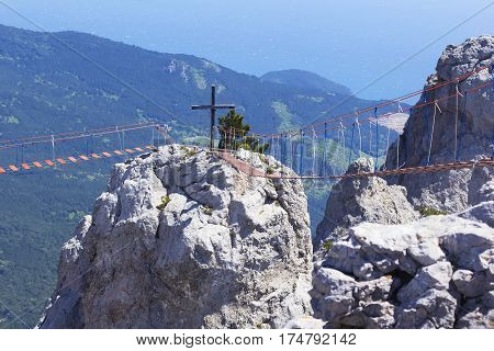 background landscape hanging rope bridges between the peaks of Mount Ai-Petri at high altitude, Yalta, Crimea