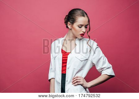 portrait of confident professional doctor in white coat on pink