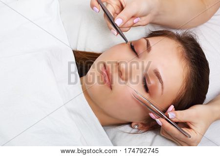 Eyelash Extension Procedure. Woman Eye with Long Eyelashes. Lashes. Close up, selectve focus.