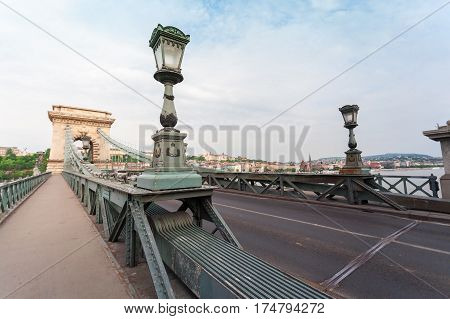 Szechenyi Chain Bridge in beautiful Budapest at sunset. Bridge over the Danube River, connects the two banks of the Buda and Pest, in the capital of Hungary.