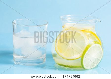 Detox drink with lemon on a blue background