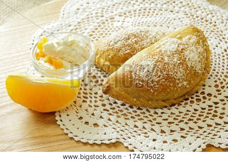 Russian pirozhki, baked patties or pies on basket with nuts and orange