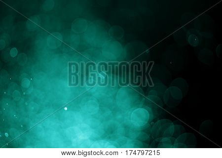 Light bokeh abstract color blurred black background