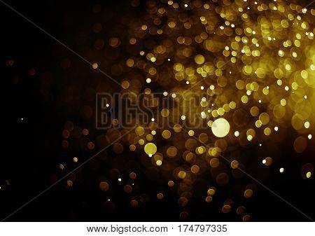 Bokeh light gold color blurred black background