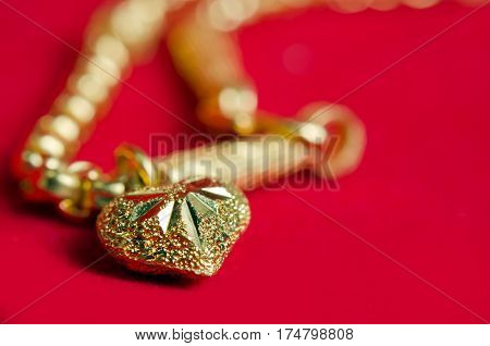 Gold Necklace 96.5 Percent Thai Gold Grade With Gold Heart Pendant Isolated On Red Flannel Cloth Bac