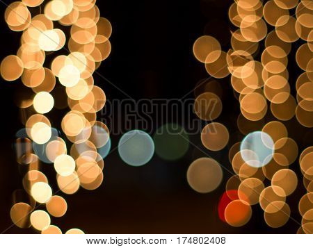 Blurred lights on night time. Background and circle bokeh for christmas and New year festival.