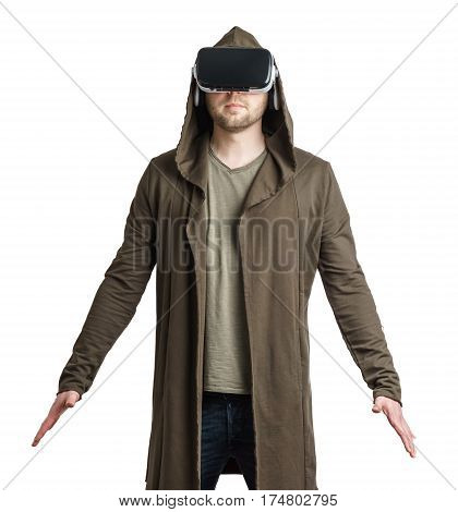 Isolated on white portrait of an young man in a hoodie wearing vr glasses.