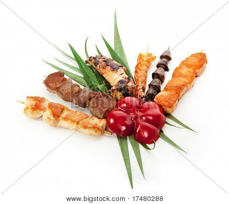 Grilled Foods Garnished with Green Leaves and Paprika