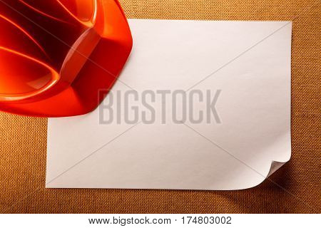 Red Helmet And Blank Paper