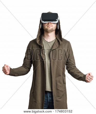 Isolated on white portrait of an young man in a hoodie wearing vr glasses and clenching his fist.