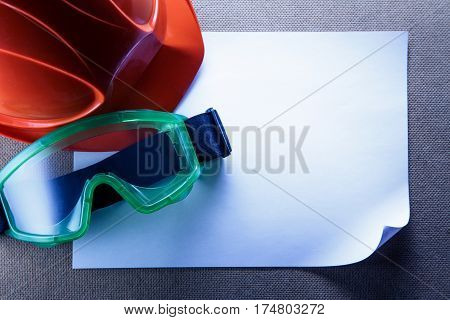 Helmet, Goggles And Blank Paper