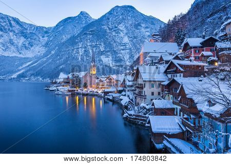 Classic View Of Hallstatt With Ship In Winter Twilight, Salzkammergut, Austria