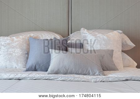 Modern Bedroom Interior With Gray And Striped Pillows On Bed