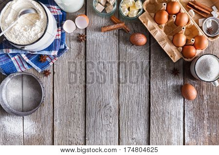 Baking background. Cooking ingredients for dough and pastry making on rustic wood. Top view with copy space, mockup for menu, recipe or culinary classes.