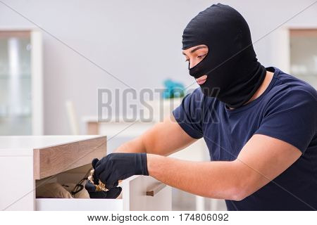 Robber wearing balaclava stealing valuable things poster