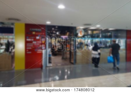 blurred photo Blurry imagePeople are interested cameras sold in the store background