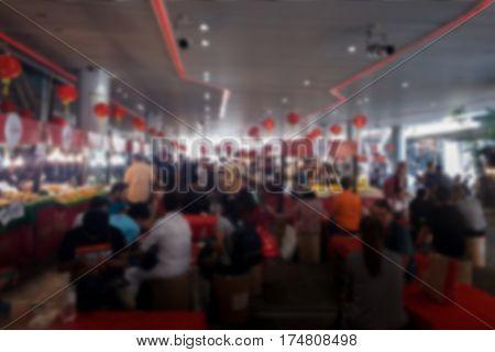 blurred photo Blurry image People walk around the flea market background