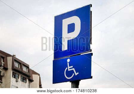 Traffic sign indicating a parking place and a place for people with disabilities with cars, Novi Sad, Serbia