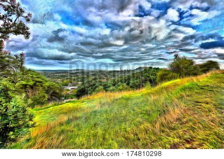 View of a verdant green countryside from a hilltop in Auckland New Zealand