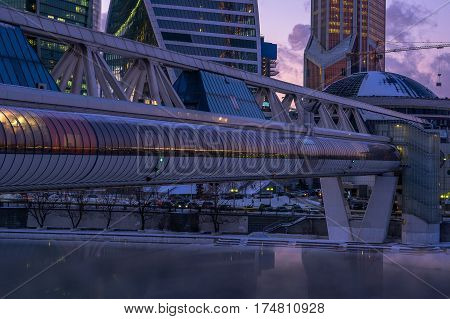 Moscow, Russia - January 25, 2017: Commerce and pedestrian bridge Bagration and the Moscow International Business Center Moscow City in the twilight time of day