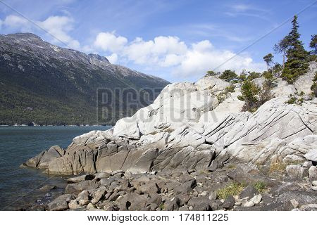 Picturesque rocky shore in Yakutania Point park Skagway town (Alaska).