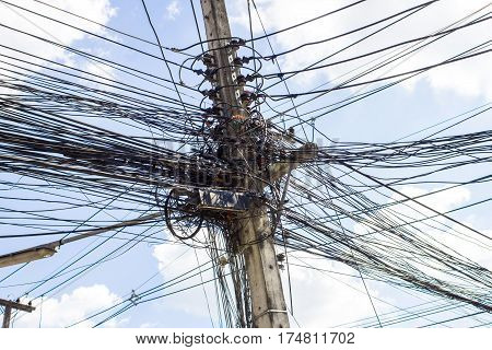Electric cables tangle on electric pole background
