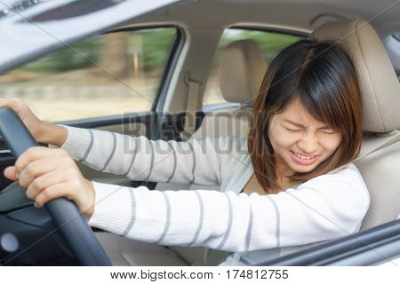 Terrified woman driving and having car accident or crash something