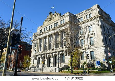 MONTREAL, CANADA - NOV 2, 2012: BAnQ Vieux-Montreal is former HEC business school with early-1900s Beaux-Arts style. Now this building is part of National Library and Archives of Quebec in Old town Montreal, Canada.