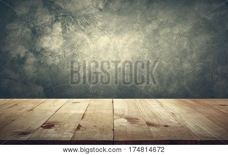 Wood table top with vintage grunge cement wall background copy space ready for your product design.