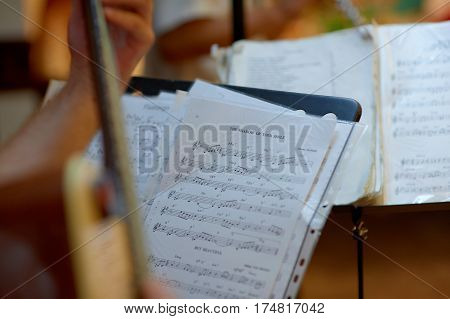 music stand with guitar notes. Pupitre with partitura